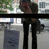 "Pedestrian reading an ""Artist's Rejection Letter"""
