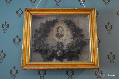 Wreath honoring that lady - made from her hair - saved in a little jar as she combed her hair every day!