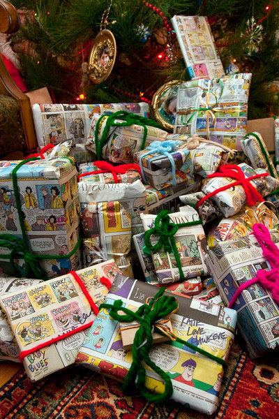 An earth-friendly and economical way to wrap presents for the holidays is to use the Sunday comics that you start saving a couple of months beforehand...reusable yarn completes the package. Wrap can go safely into the recycling bin after it's two uses.