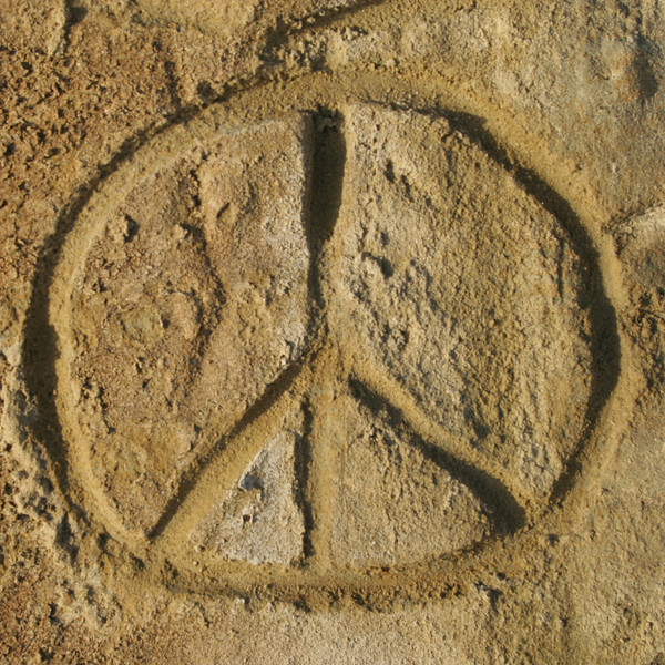 Peace sign carved in sandstone cliff, Carmel, CA