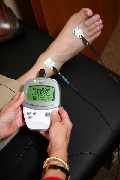 A device created by NASA, the Impedimed, which measures body fat, muscle mass, and hydration percentages in your body and translates it into a graph on the computer is utilized as part of the program at The Marin Plan, seen administered here by Gail Harris in her Sausalito office on November 13, 2010.