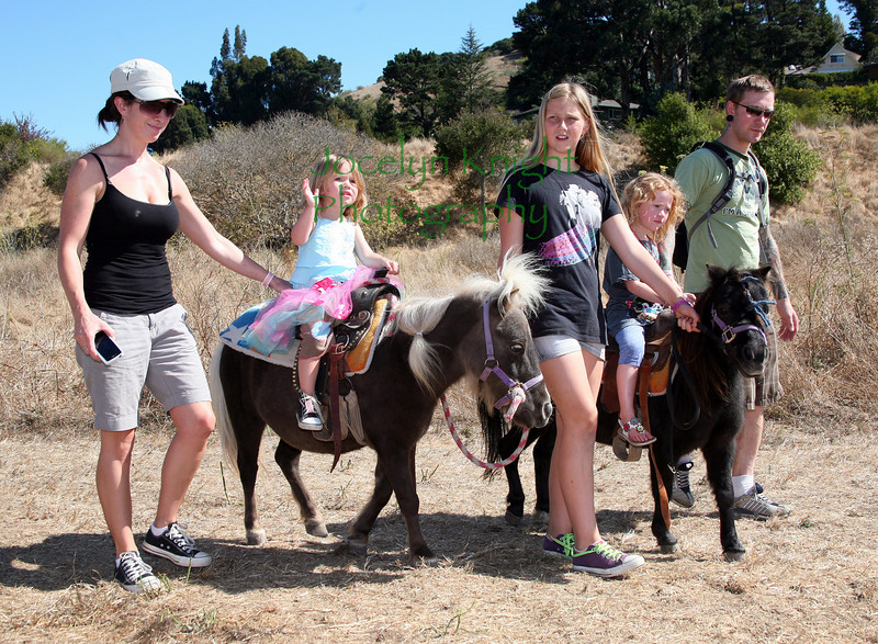 Pony and Horse rides were a big hit at Blackie's Hay Day in Blackie's Pasture, Tibuon, Ca on Sept 25, 2010.(left to right- Risa Degeorgey, her daughter Sierra, 2, Volunteer Christa Curry, Aavi Ots, 4, and her dad, Hannes Ots.