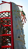 Charlotte Hall, 9,  of Belvedere, scales the rock wall structure while other kids climb up the inside at Blackie's Hay Day in Blackie's Pasture on Saturday, September 25, 2010.