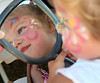 Bella Starnes, 2, of  Tiburon admires her face paint at Blackie's Hay Day in Blackie's Pasture, Tiburon, on September 25, 2010.