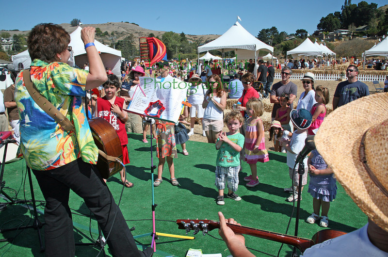 Dream Circle, a musical group of kid's music superstars including Tim Cain,  Judy Nee (Miss Kitty) Christopher Smith and others get the kids dancing at Blackie's Hay Day in Blackie's pasture, Tiburon, CA on a hot September 25, 2010.