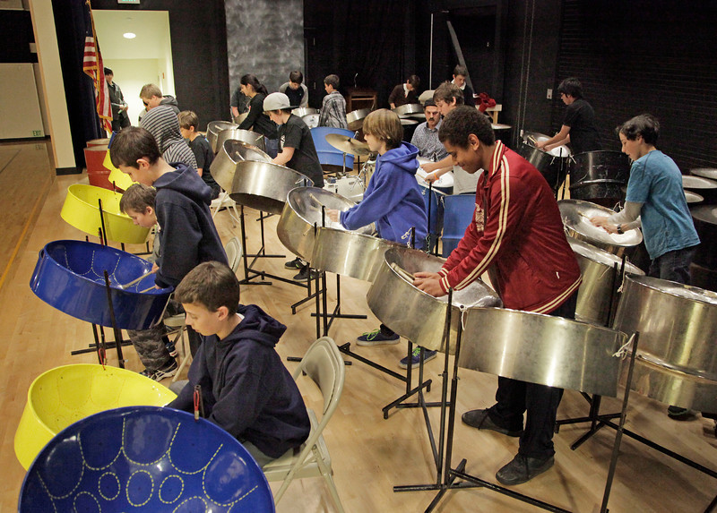 Del Mar Middle School students perform in the Steel Band Winter Concert with teacher Jeff Narell , center, with black hat, at Del Mar School in Tiburon, Calif.  on Thursday, December 13, 2012.  The music ranged from traditional, as in IKO IKO, to Walking on the Moon by Sting.Bob Marley favorite Roots Rock Reggae,  Jambalaya by Fats Domino, Green Onions by Booker T and the MG's, Land Down Under by Men at Work, All day and All of the NIght  and You Really Got Me by the Kinks, and Whole Lotta Shakin Goin On by Little Richard were some of the selections played. (Jocelyn Knight Photo)