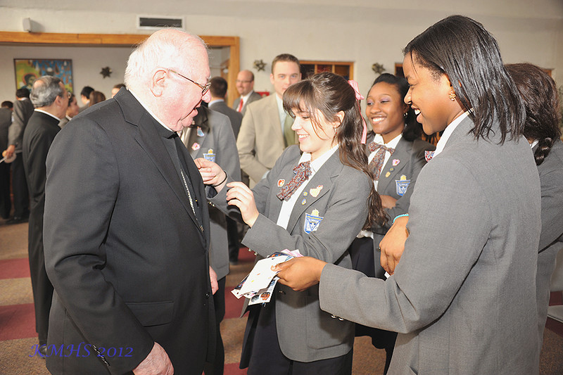 Capri Pappalardo was given the honor of putting the sticker upon the Bishop's lapel.
