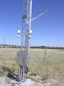 Lower section of meteorological tower, showing fan-aspirated RH and 2m Temp blowers, photosynthetic active solar radiation sensor, barometric pressure and signal junction box