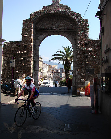 Sicily - An Arch and a Cyclist