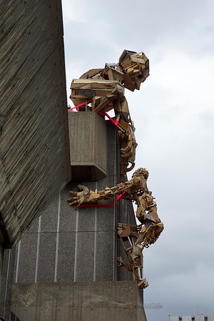 Salvaged Wood Statues Climbing