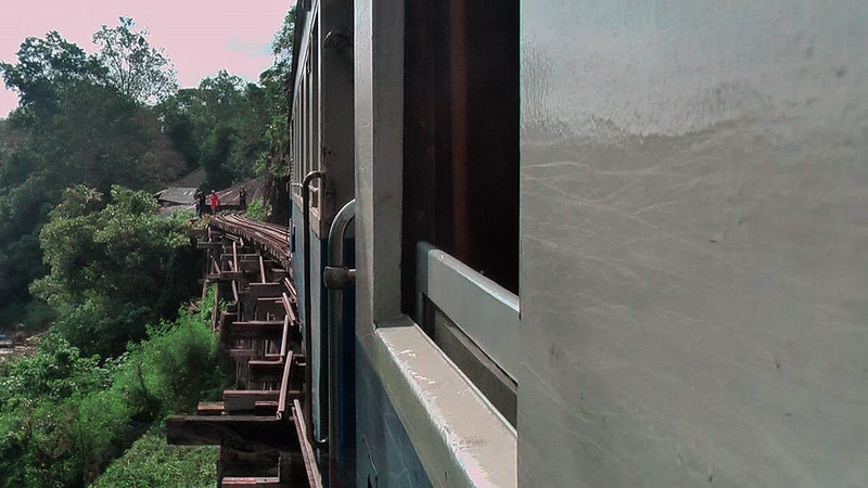 Train over a Wooden Bridge in Thailand