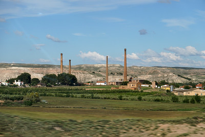 View of Chimneys from a Train Window