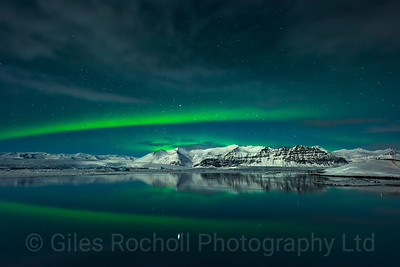 The northern lights illuminate the lagoon at Jokulsarlon, Iceland photo tour, February 2016