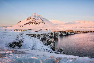 Morning breaks over th e sleepy fishing village of Arnarstarpi, Iceland photo tour, February 2016