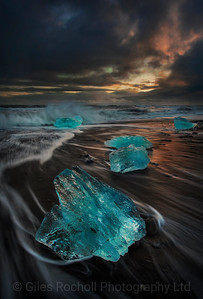 Sea ice illuminated by the setting sun, Jokulsarlon beach, Iceland