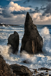 Sea storm around sea stacks near Sandvik,Iceland