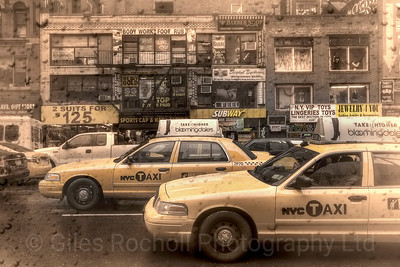 Steamy windows New York City yellow cabs stuck in traffic. September 2011.