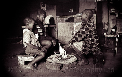 Keeping warm round the fire, Queenstown, South Africa 1987-1991