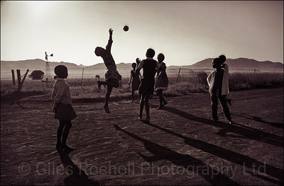 Children playing ball on their way to school near Queenstown, South Africa 1987-1991
