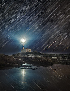 Star trails over Favàritx lighthouse, Menorca. PhotoPills Camp May 2018
