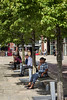 Sunshine, shoppers, pedestrians benches, sitting,Granary Wharf, Canal Side, Leeds West Yorkshire, United Kingdom.