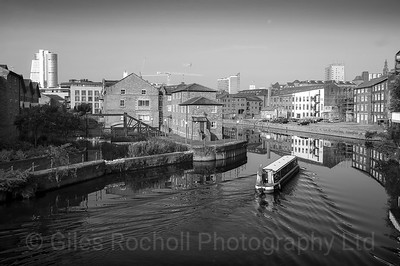 Canal boat approaches Leeds West Yorkshire