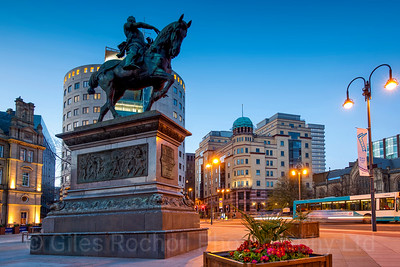 Sunset over Leeds City Square and Black Prince Statue, Leeds, West Yorkshire, United Kingdom