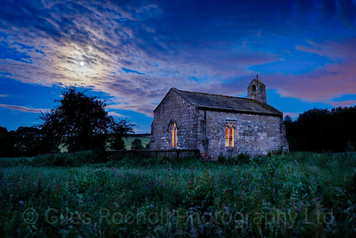 Soltice full moon over St Mary's Church, Lead near Tadcaster, North Yorkshire, United Kingdom.