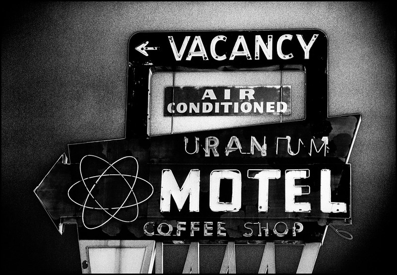 An old fashioned solarized b&w print of signage of a Grand Junction CO Motel that is long gone.  Circa 1997.  The original b&w negative is a bad dreary daylight shot that's back-lite.  In the solarization process most of the image reverses to a negative but not all.  It's a fun process, but very unpredictable.  And it tends to draw an interesting white line around parts of the image.
