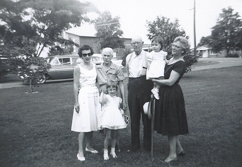 2. A family picture from about 1961. Aunt Pauline at right holding her granddaughter Judy; my granddad Bud Barrett and my grandmother Nell Barrett. Cousin Donna at left and her daughter Debbie in front.<br /> <br /> WHILE IN BIRMINGHAM IN JANUARY 2017 I TOOK PICTURES OF ALL THE PAINTINGS DONNA STILL HAS AT HER HOME. I'VE ALSO CONTACTED COUSINS TO REQUEST THEM TO SEND ME PICTURES OF ANY PAINTINGS DONE BY DONNA OR HER MOTHER, MY AUNT PAULINE SMITH.<br /> <br /> I APOLOGIZE FOR THE POOR QUALITY OF THESE COPIES. I SHOT THEM WITH MY IPAD AND MANY ARE NOT WELL FOCUSED.  ALSO, BECAUSE OF THE WAY THEY WERE HUNG ON THE WALL, I WAS NOT ABLE TO SHOOT SQUARELY, TO KEEP THE PERSPECTIVE  CORRECT.<br /> <br /> I understand from Donna that she did not 'name' any paintings, so just to help keep them straight and identify them, I'm given them names descriptive of the subject. The still life ones I call SL 1 , SL 2, etc.  The landscapes are designated LDSCP. <br /> <br /> These are not presented in any chronological order, but I have placed them in somewhat of a 'subject' order. <br /> Still life<br /> Animals<br /> Western<br /> Beach or Seascape<br /> Landscape/Buildings<br /> Floral<br /> Females<br /> Animals<br /> Males<br /> Misc<br /> Aunt Pauline's Paintings<br /> Judy's Paintings<br /> Debbie's Paintings<br /> Other Painters