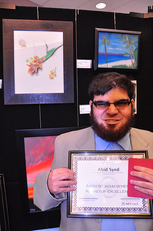 A terrific art student place through DARS- Abid Syed wins an artistic achievement award in drawing and illustration.