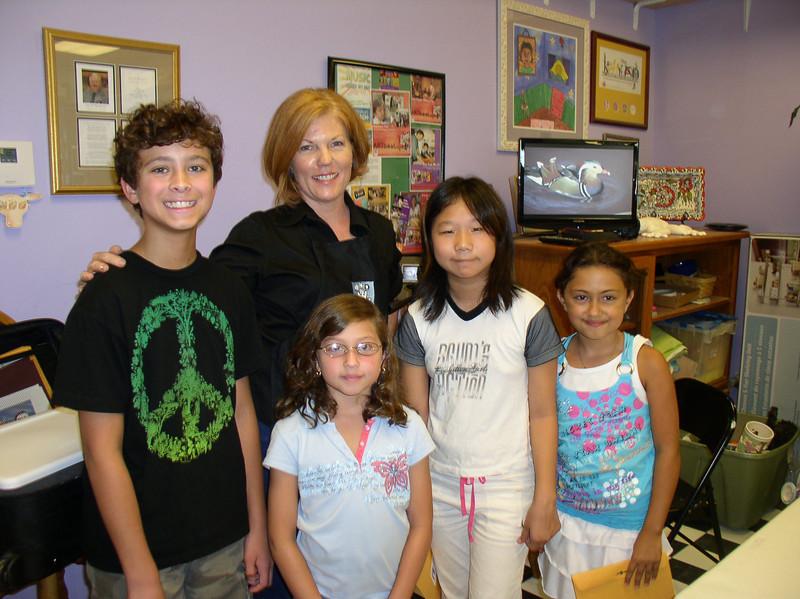 Artist Elizabeth Linder with her award winning students in Katy