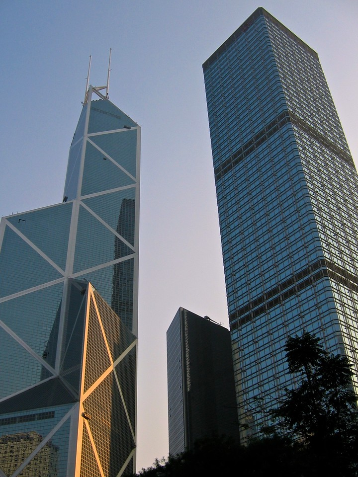 The Bank of China tower in Central Hong Kong is on the left.  Designed by I. M. Pei, the building is 305 m (1,000.7 ft) high with two masts reaching 367.4 m (1,205.4 ft) high. It was the tallest building in Hong Kong and Asia from 1989 to 1992, and it was the first building outside the United States to break the 305 m (1,000 ft) mark. It is now the third tallest skyscraper in Hong Kong, after Two International Finance Centre and Central Plaza.<br /> <br /> On the right is Cheung Kong Center, designed by Cesar Pelli. It is 68 stories tall with height of 283 m (928 ft).  When completed in 1999, it was the third-tallest building in the city.