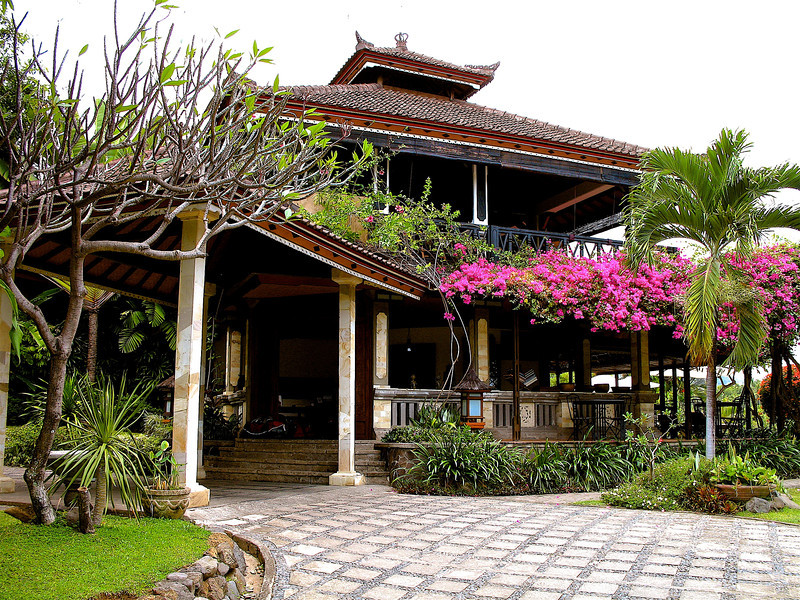 The hotel has only 8 villas, so there's only a maximum of 16 guests at any one time.  Here's the main reception building with the restaurant on the top.