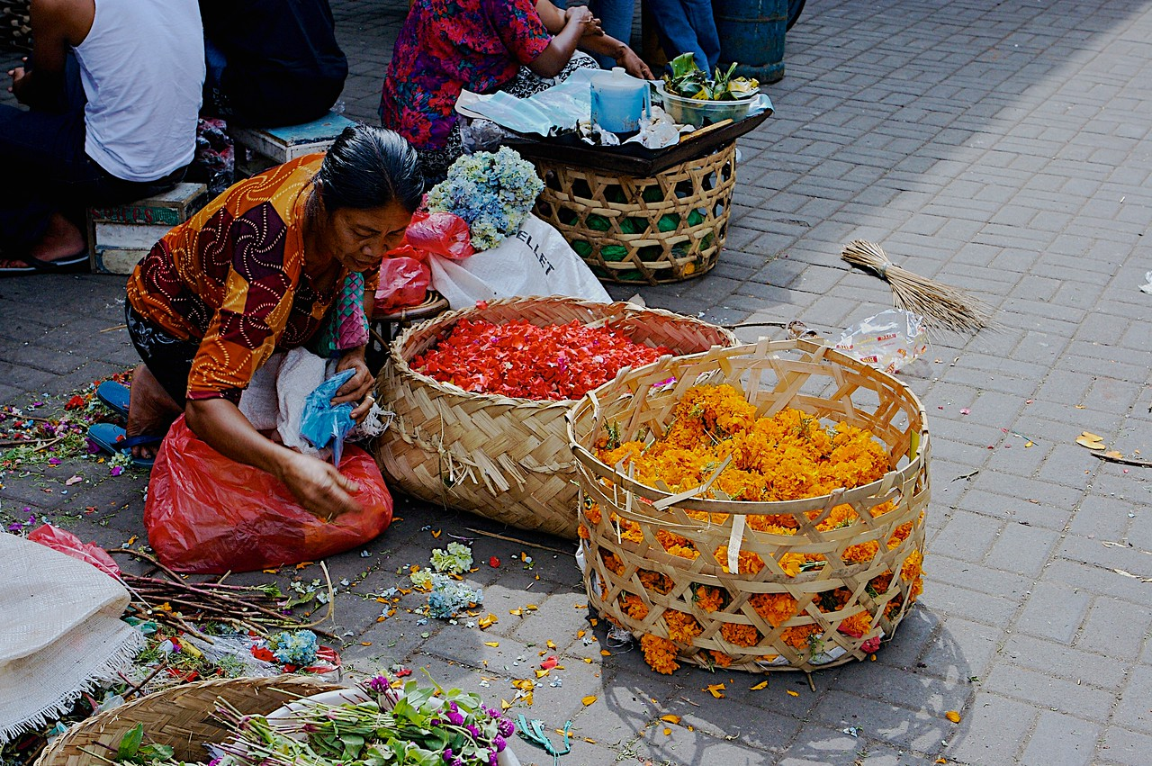 In the market courtyard, you'll find women working with local flowers.