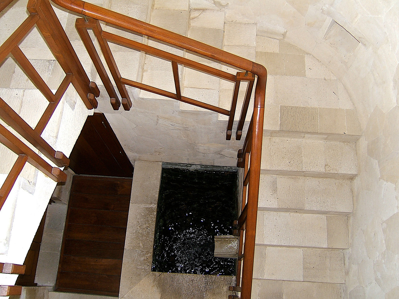 The stairway from the top of the lily pond, to the room below with a small fountain outside.