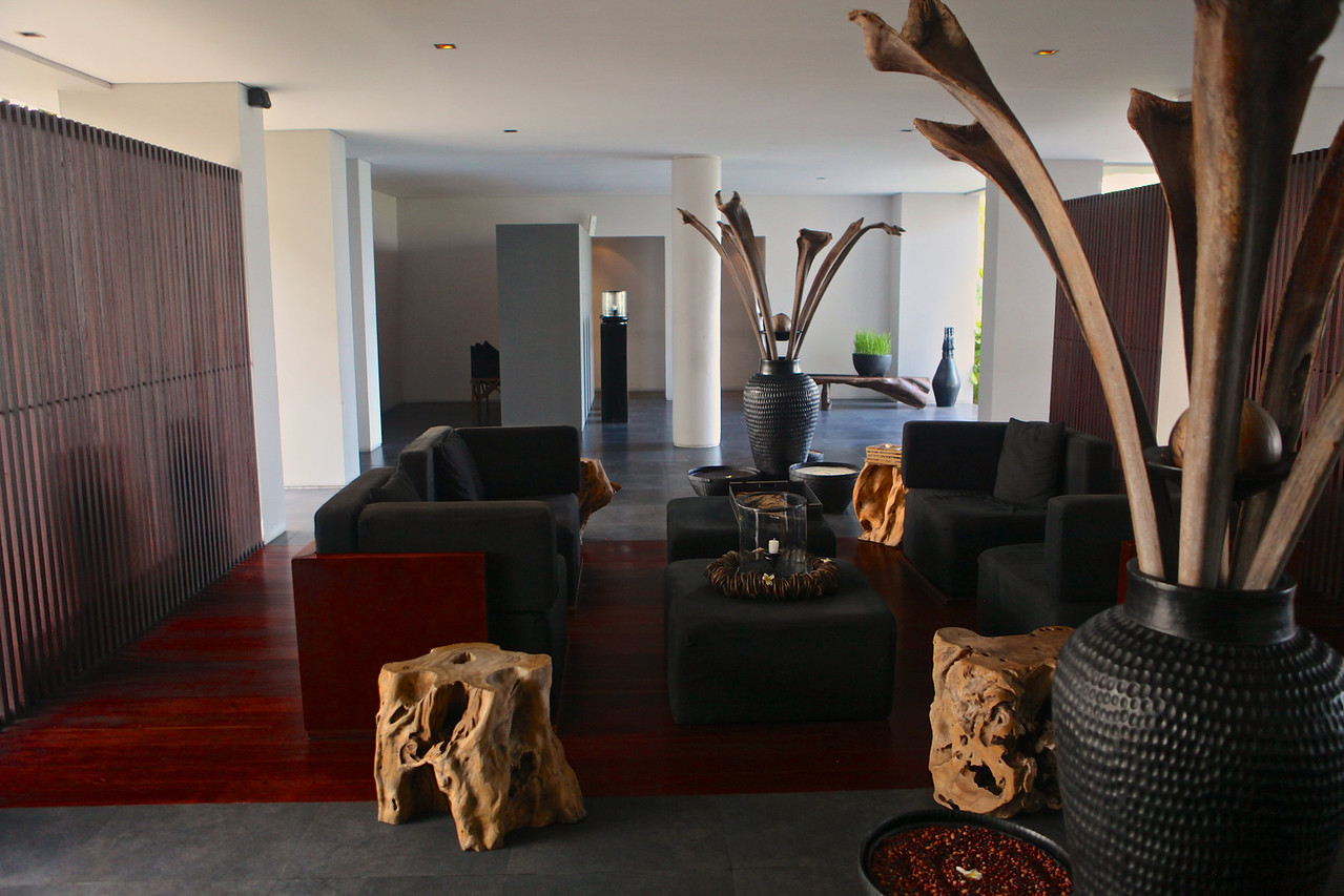 The lobby, featuring frangipani tree trunk tables.