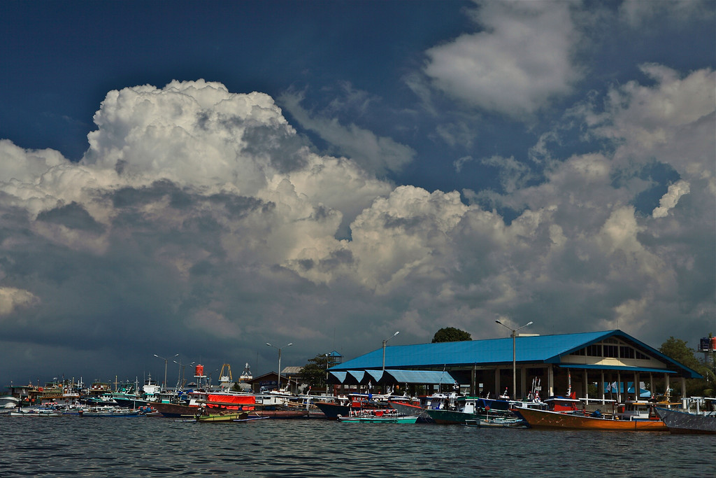Most of the boats are painted with very bright colors.  Here's the marina in Bintung.
