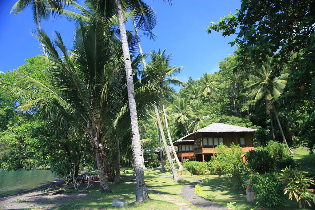 Traditional Indonesia beach houses line the beach.