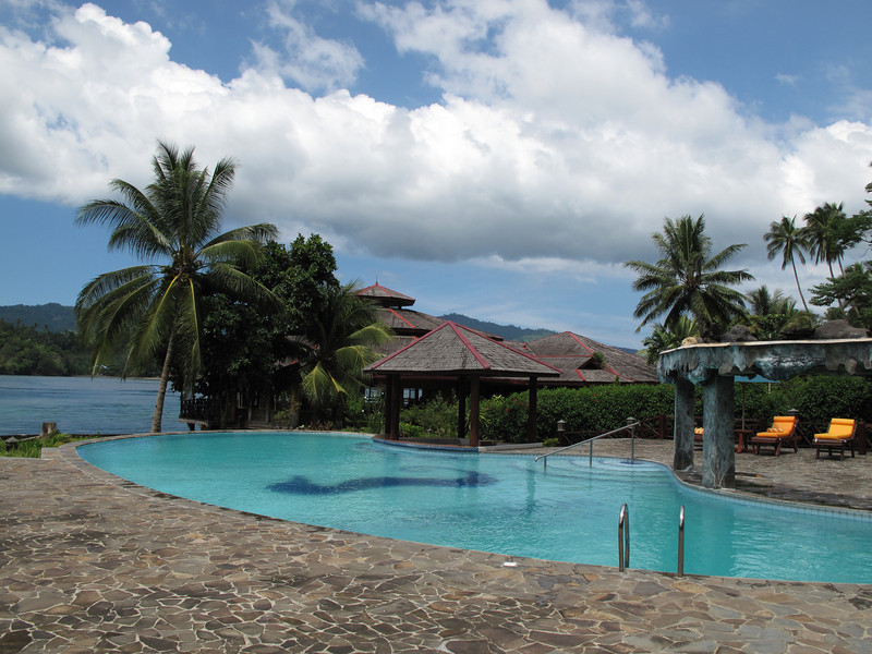 The pool sits in front of the spa and overlooks the water.
