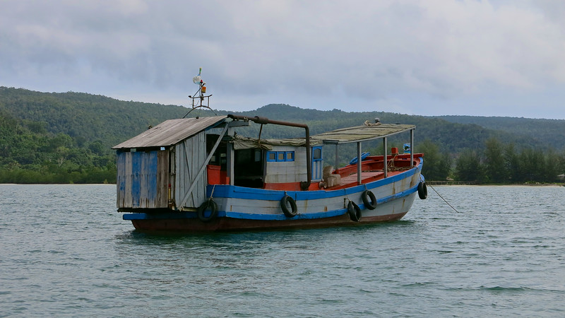 This is actually a ferry boat used by one of the backpacker lodges on the main island of Koh Rong.  That's a bathroom hanging off the back, btw.