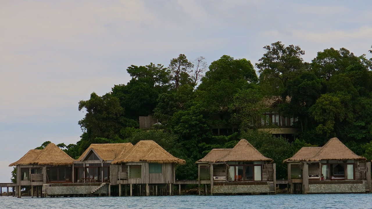 Behind the overwater villas, you can see the jungle villas up above.