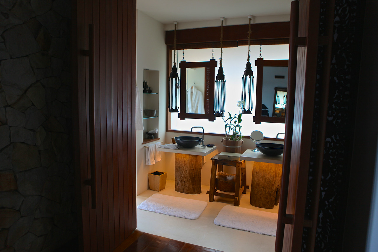 The bathroom area is large, with double sinks.