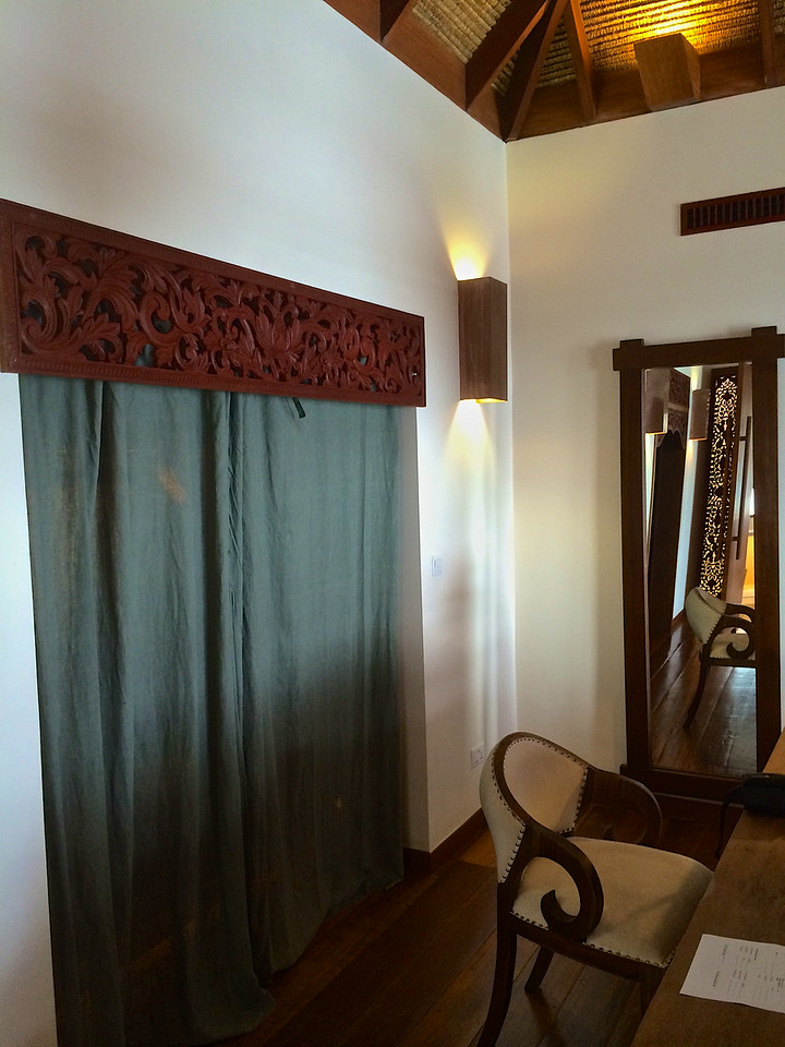 Behind the curtain is a large closet with hanging space, shelves and an electronic safe.  Laundry service is provided free.