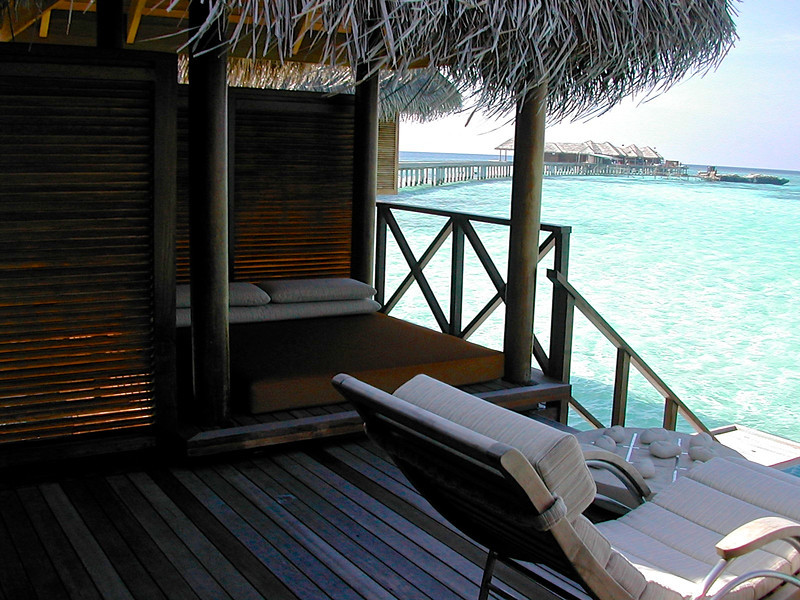 A shaded daybed and deck lookout over the lagoon.