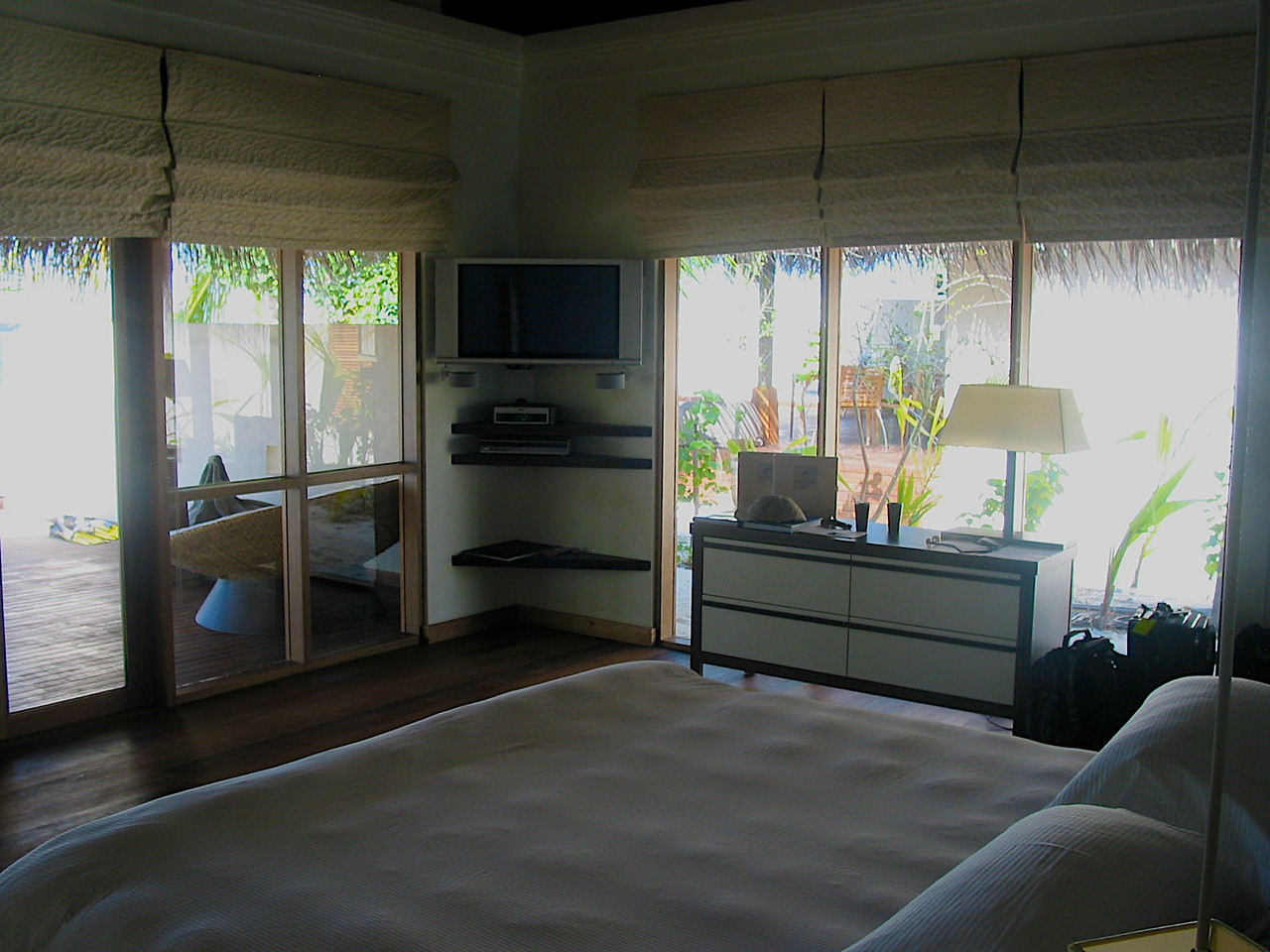 Rooms are large with teak wood floors.