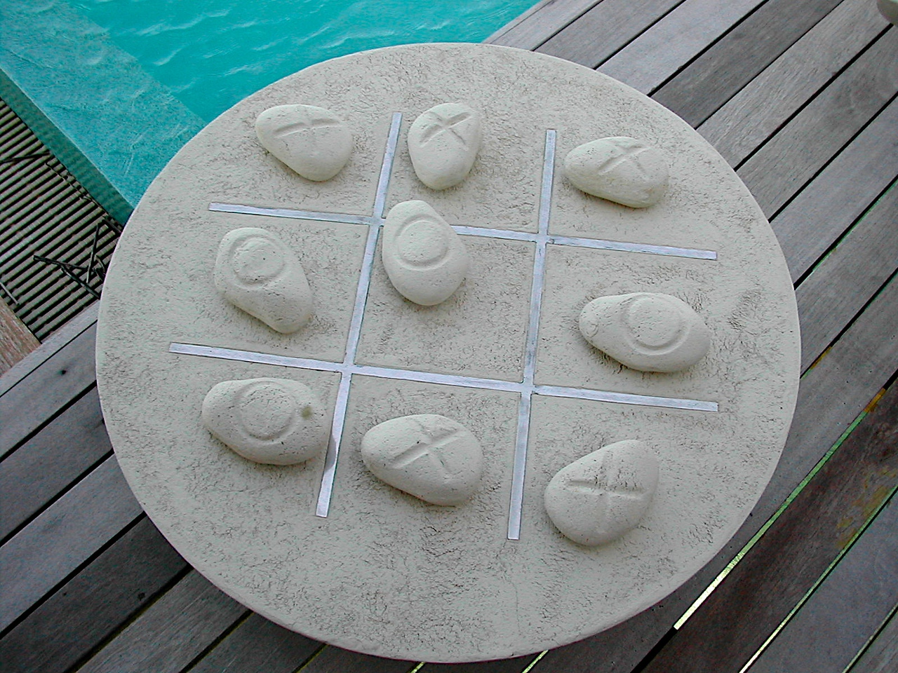 For games, play Tic Tac Toe on your own stone game set on your deck.