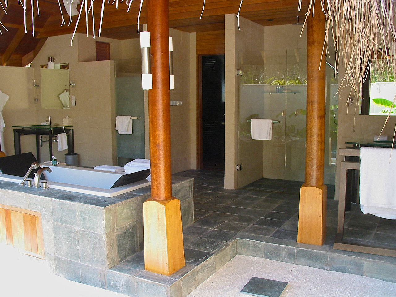 The rest of the bathroom is outside as well, along with double vanities and a second outdoor shower.