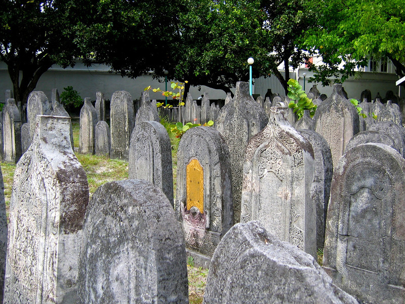 Maldivian tombstones have a unique feature.  A tombstone with a rounded top is used for a woman, while a tombstone with a pointed top indicates a man's grave.
