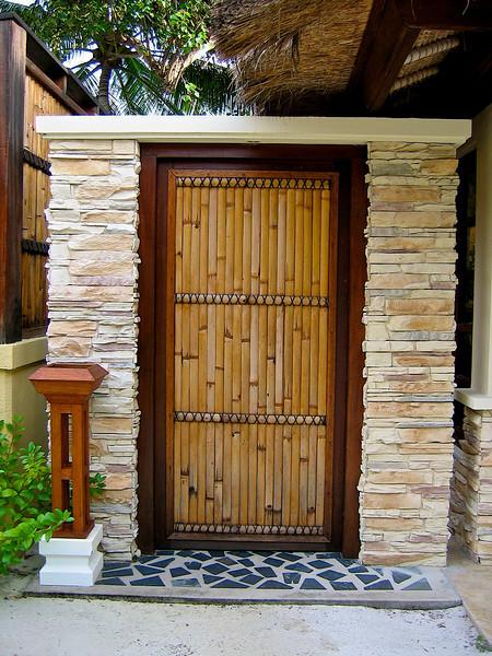 You enter your villa compound through a bamboo door.